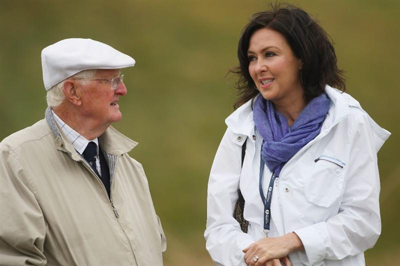 TURNBERRY, SCOTLAND - JULY 17:  James Montgomerie and Gaynor Montgomerie chat during round two of the 138th Open Championship on the Ailsa Course, Turnberry Golf Club on July 17, 2009 in Turnberry, Scotland.  (Photo by Andrew Redington/Getty Images)