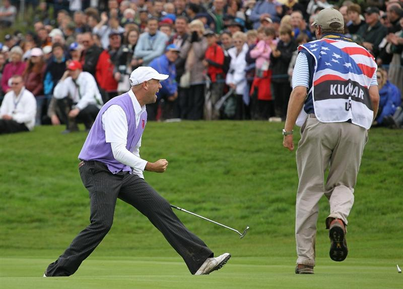NEWPORT, WALES - OCTOBER 02:  Stewart Cink of the USA celebrates a birdie putt on the 17th green alongside caddie Lance Bennett during the rescheduled Afternoon Foursome Matches during the 2010 Ryder Cup at the Celtic Manor Resort on October 2, 2010 in Newport, Wales.  (Photo by Andy Lyons/Getty Images)