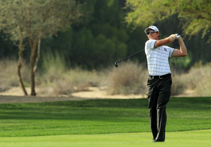 DUBAI, UNITED ARAB EMIRATES - FEBRUARY 11:  Brett Rumford of Australia plays his third shot at the par 5, 3rd hole during the second round of the 2011 Omega Dubai Desert Classic on the Majilis Course at the Emirates Golf Club on February 11, 2011 in Dubai, United Arab Emirates.  (Photo by David Cannon/Getty Images)