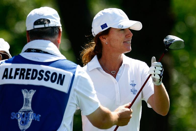 SUGAR GROVE, IL - AUGUST 18:  Helen Alfredsson of the European Team takes a club from her caddie  during a practice round prior to the start of the 2009 Solheim Cup at Rich Harvest Farms on August 18, 2009 in Sugar Grove, Illinois.  (Photo by Scott Halleran/Getty Images)