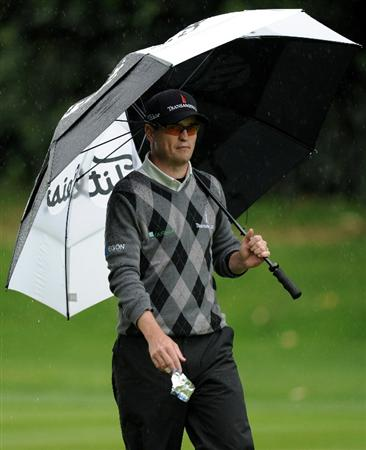 PACIFIC PALISADES, CA - FEBRUARY 18:  Zach Johnson makes takes out his umbrella on the 12th fairway during the second round of the Northern Trust Open at the Riviera Country Club on February 18, 2011 in Pacific Palisades, California.  (Photo by Harry How/Getty Images)