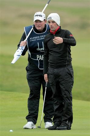 CARNOUSTIE, SCOTLAND - OCTOBER 09:  John Parry of England lines up his putt with his caddie on the third green during the third round of The Alfred Dunhill Links Championship at the Carnoustie Golf Links on October 9, 2010 in Carnoustie, Scotland.  (Photo by David Cannon/Getty Images)