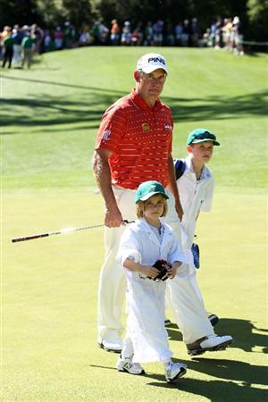 AUGUSTA, GA - APRIL 06:  Lee Westwood of England walks across a green with his children, Sam and Poppy, during the Par 3 Contest prior to the 2011 Masters Tournament at Augusta National Golf Club on April 6, 2011 in Augusta, Georgia.  (Photo by Andrew Redington/Getty Images)