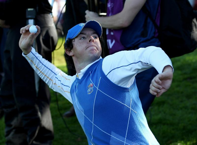 NEWPORT, WALES - OCTOBER 04:  Rory McIlroy of Europe throws his ball to the crowd on the 18th green after he halved his match in the singles matches during the 2010 Ryder Cup at the Celtic Manor Resort on October 4, 2010 in Newport, Wales.  (Photo by Ross Kinnaird/Getty Images)
