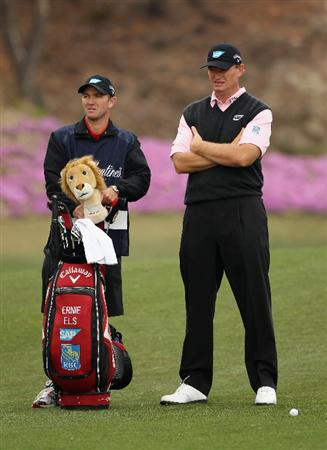ICHEON, SOUTH KOREA - APRIL 28:  Ernie Els of South Africa and his caddie Michael Kerr during the first round of the Ballantine's Championship at Blackstone Golf Club on April 28, 2011 in Icheon, South Korea.  (Photo by Andrew Redington/Getty Images)