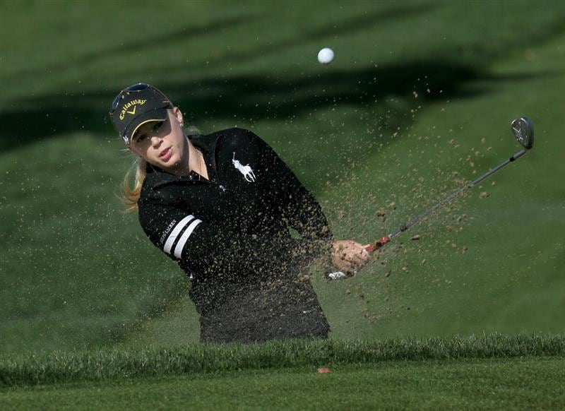 RANCHO MIRAGE, CA - APRIL 01:  Morgan Pressel hits from a bunker on the 12th hole during the first round of the Kraft Nabisco Championship at Mission Hills Country Club on April 1, 2010 in Rancho Mirage, California.  (Photo by Stephen Dunn/Getty Images)