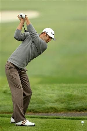 PEBBLE BEACH, CA - JUNE 14:  Dustin Johnson hits a tee shot during a practice round prior to the start of the 110th U.S. Open at Pebble Beach Golf Links on June 14, 2010 in Pebble Beach, California.  (Photo by Ross Kinnaird/Getty Images)