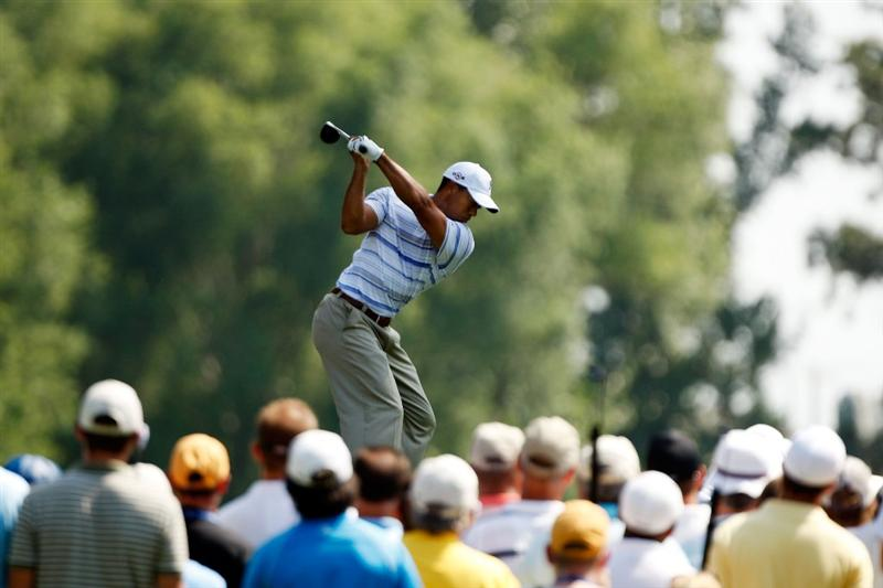 CHASKA, MN - AUGUST 14:  Tiger Woods hits his tee shot on the fifth hole during the second round of the 91st PGA Championship at Hazeltine National Golf Club on August 14, 2009 in Chaska, Minnesota.  (Photo by Streeter Lecka/Getty Images)