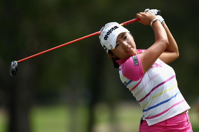 GOLD COAST, AUSTRALIA - MARCH 07:  Bo-Mee Lee of Korea plays a fairway wood on the 12th hole during round four of the 2010 ANZ Ladies Masters at Royal Pines Resort on March 7, 2010 in Gold Coast, Australia.  (Photo by Ryan Pierse/Getty Images)