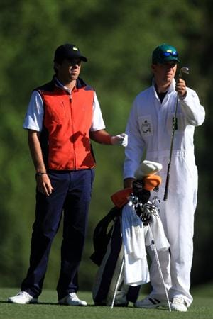 AUGUSTA, GA - APRIL 09:  Amateur Ben Martin stands alongside his caddie Robert Thompson who pulls a club from his bag on the fifth fairway during the second round of the 2010 Masters Tournament at Augusta National Golf Club on April 9, 2010 in Augusta, Georgia.  (Photo by David Cannon/Getty Images)