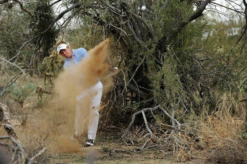 MARANA, AZ - FEBRUARY 26:  Luke Donald of England hits his second shot on the 11th hole during the semifinal round of the Accenture Match Play Championship at the Ritz-Carlton Golf Club on February 26, 2011 in Marana, Arizona.  (Photo by Stuart Franklin/Getty Images)