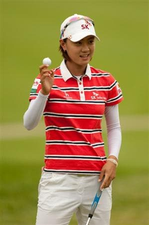 SPRINGFIELD, IL - JUNE 10: Na Yeon Choi of South Korea smiles and raises her ball to acknowledge the crowd after sinking a birdie putt on the ninth hole during the first round of the LPGA State Farm Classic at Panther Creek Country Club on June 10, 2010 in Springfield, Illinois. (Photo by Darren Carroll/Getty Images)