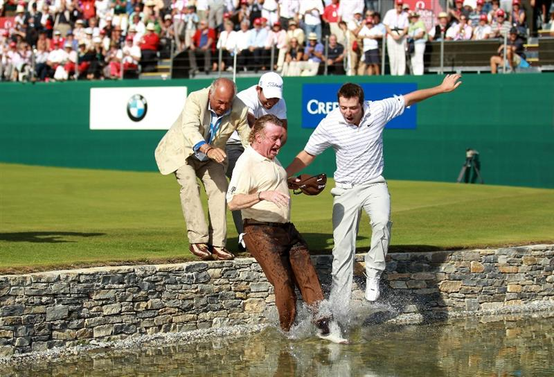 CRANS, SWITZERLAND - SEPTEMBER 05:  Miguel Angel Jimenez of Spain is pushed into the water by the 18th green by fellow Spanish players Pablo Larrazabal and Pablo Martin after winning The Omega European Masters on a score of -21 under par at Crans-Sur-Sierre Golf Club on September 5, 2010 in Crans Montana, Switzerland.  (Photo by Warren Little/Getty Images)