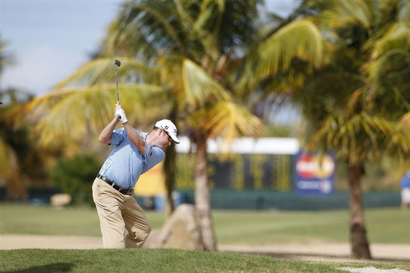 RIO GRANDE, PR - MARCH 13:  Troy Matteson hits his second shot on the 15th hole from a fairway bunker during the final round of the Puerto Rico Open presented by seepuertorico.com at Trump International Golf Club on March 13, 2011 in Rio Grande, Puerto Rico.  (Photo by Michael Cohen/Getty Images)