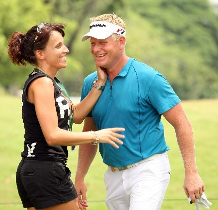 KUALA LUMPUR, MALAYSIA - MARCH 07:  Peter Hedblom of Sweden is congratulated by a fan after a birdie on the par three 6th hole during the second round of the Maybank Malaysian Open held at the Kota Permai Golf & Country Club on March 7, 2008 in Kuala Lumpur, Malaysia  (Photo by Ross Kinnaird/Getty Images)
