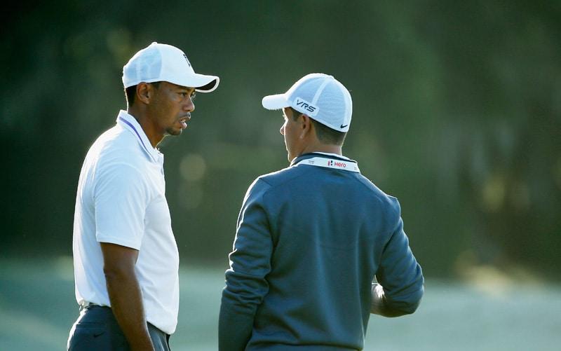 Chris Como and Tiger Woods