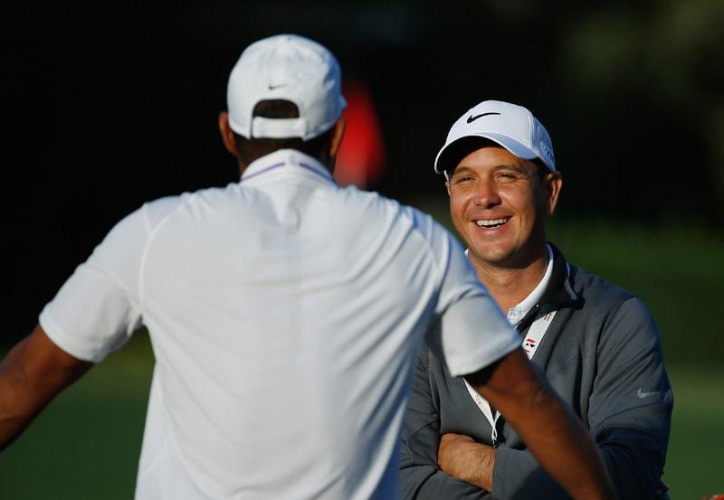 Tiger Woods and Chris Como
