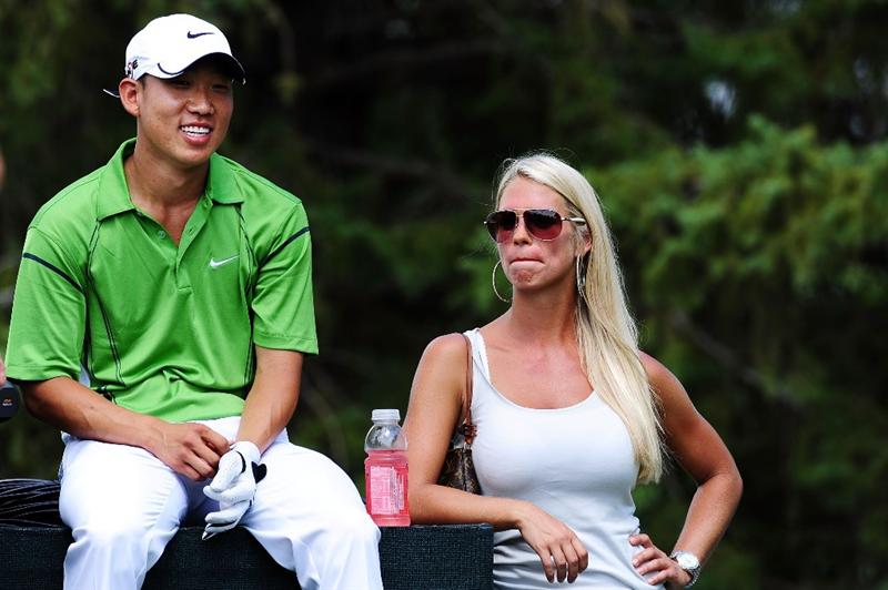 CHASKA, MN - AUGUST 12:  Anthony Kim waits with his companion during the third preview day of the 91st PGA Championship at Hazeltine National Golf Club on August 12, 2009 in Chaska, Minnesota.  (Photo by Stuart Franklin/Getty Images)