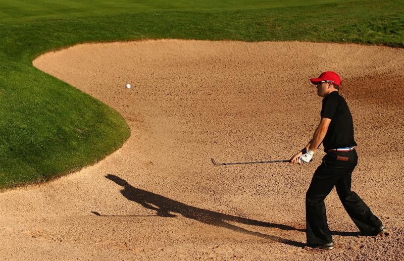 NEWPORT, WALES - OCTOBER 04: Zach Johnson of the USA plays from a bunker on the 16th hole in the singles matches during the 2010 Ryder Cup at the Celtic Manor Resort on October 4, 2010 in Newport, Wales. (Photo by Richard Heathcote/Getty Images)