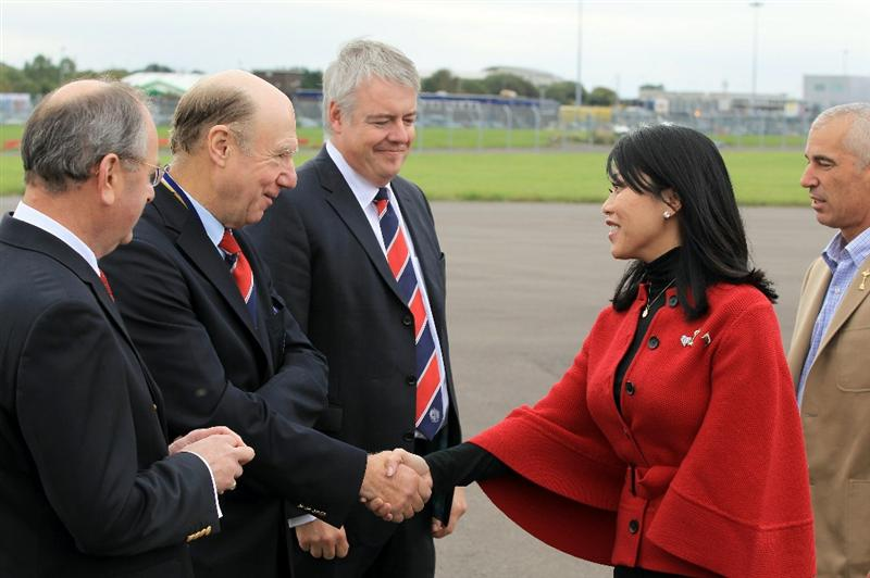 CARDIFF, WALES - SEPTEMBER 27:  In this handout image provided by Ryder Cup Europe, John Jermine, chairman of Ryder Cup Wales welcomes Corey Pavin's wife Lisa Pavin as the US team arrive at Cardiff Airport prior to the start of the 2010 Ryder Cup on September 27, 2010 in Cardiff, Wales.  (Photo by Ryder Cup Europe via Getty Images).