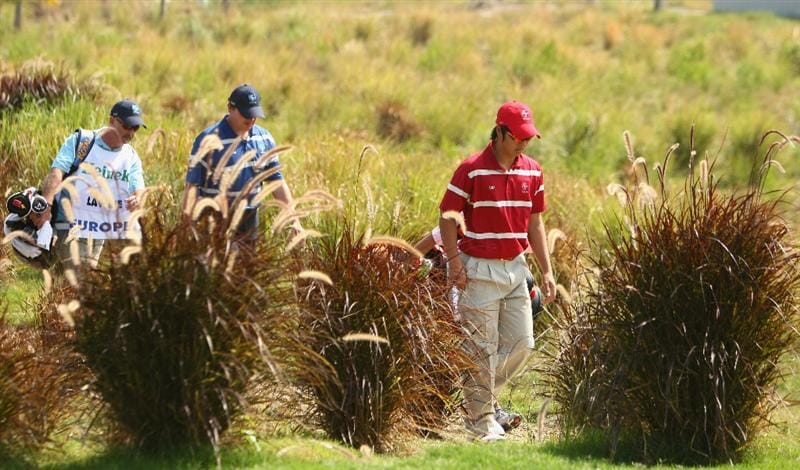 BANGKOK, THAILAND - JANUARY 09:  Ryo Lshikawa of Japan walks to the 2nd green during the foursomes on Day one of The Royal Trophy at the Amata Spring Country Club on January 9, 2009 in Bangkok, Thailand.  (Photo by Ian Walton/Getty Images)