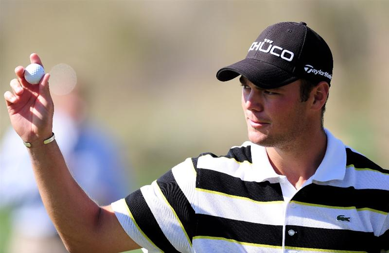 MARANA, AZ - FEBRUARY 18:  Martin Kaymer of Germany waves his golf ball on the 13th hole during round two of the Accenture Match Play Championship at the Ritz-Carlton Golf Club on February 18, 2010 in Marana, Arizona.  (Photo by Stuart Franklin/Getty Images)
