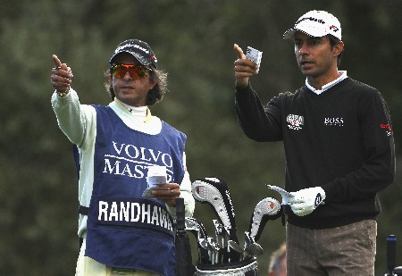 SOTOGRANDE, SPAIN - NOVEMBER 01:  Jyoti Randahwa of India and his caddie and cousin Bunty Randhawa gesture on the second hole during the first round of the Volvo Masters at Valderrama Golf Club on November 1, 2007 in Sotogrande, Spain.  (Photo by Andrew Redington/Getty Images)