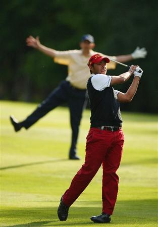 WENTWORTH, ENGLAND - MAY 21:  Pablo Larrazabal of Spain plays into the 13th green as Peter Lawrie of Ireland jokes about behind during the First Round of the BMW PGA Championship at Wentworth on May 21, 2009 in Virginia Water, England.  (Photo by Ian Walton/Getty Images)