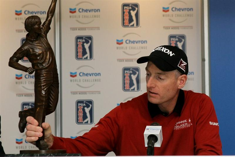 THOUSAND OAKS, CA - DECEMBER 04:  Jim Furyk handles the trophy he was awarded for being voted PGA tour Player of the Year during a cermony and press conference after round three of the Chevron World Challenge at Sherwood Country Club on December 4, 2010 in Thousand Oaks, California.  The trophy is a statue of Jack Nicklaus.  (Photo by Stephen Dunn/Getty Images)