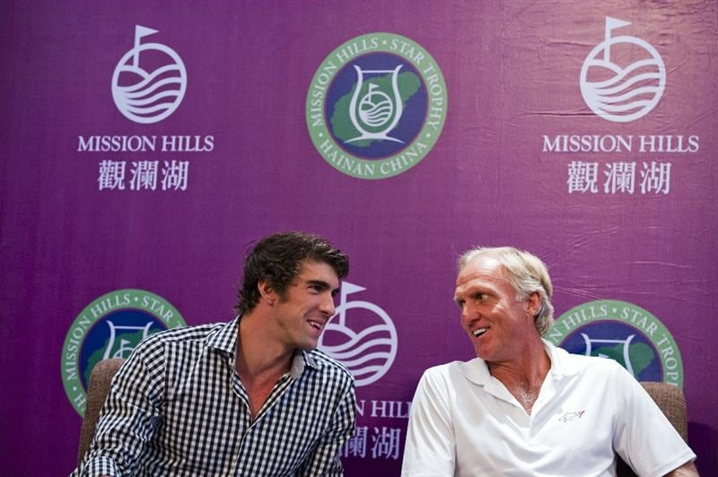 HAIKOU, CHINA - OCTOBER 27:  (L-R) Multiple Olympic gold medalist Michael Phelps of USA and golf legend Greg Norman of Australia attend the opening press conference of the Mission Hills Star Trophy on October 27, 2010 in Haikou, China. The Mission Hills Star Trophy is Asia's leading leisure liflestyle event and features Hollywood celebrities and international golf stars.  (Photo by Victor Fraile/Getty Images)