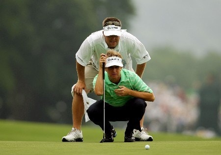 OAKMONT, PA - JUNE 14:  David Toms and his caddie Adam Hayes line up a putt during the first round of the 107th U.S. Open Championship at Oakmont Country Club on June 14, 2007 in Oakmont, Pennsylvania.  (Photo by Harry How/Getty Images)