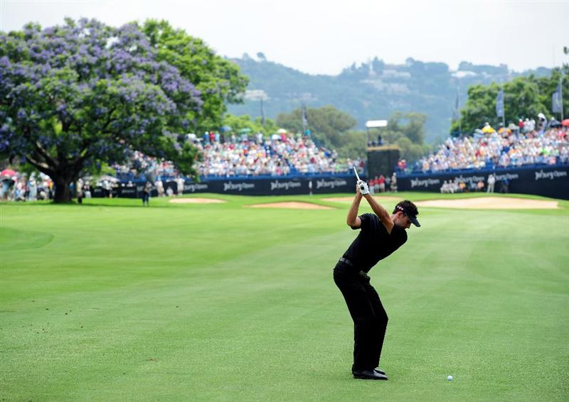 JOHANNESBURG, SOUTH AFRICA - JANUARY 17:  Charl Schwartzel of South Africa plays his approach shot on the 18th hole during the final round of the Joburg Open at Royal Johannesburg and Kensington Golf Club on January 17, 2010 in Johannesburg, South Africa.  (Photo by Stuart Franklin/Getty Images)