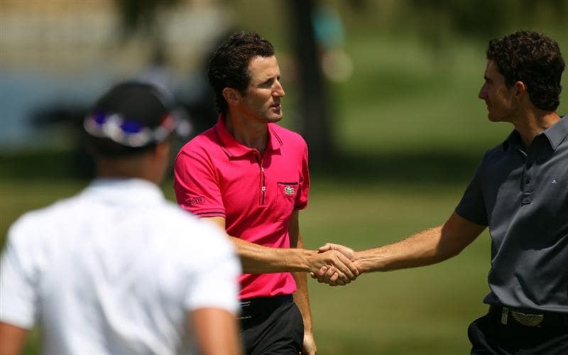 MALLORCA, SPAIN - MAY 12:  Gregory Bourdy of France is congratulated by Alejandro Canizares (R) of Spain and Danny Willett of England after their round together during day one of the Iberdrola Open at Pula Golf Club on May 12, 2011 in Mallorca, Spain.  (Photo by Julian Finney/Getty Images)