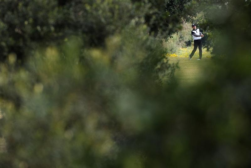 RAGUSA, ITALY - MARCH 20:  Ignacio Garrido of Spain plays his approach shot on the fourth hole during the final round of the Sicilian Open at the Donnafugata golf resort and spa on March 20, 2011 in Ragusa, Italy.  (Photo by Stuart Franklin/Getty Images)
