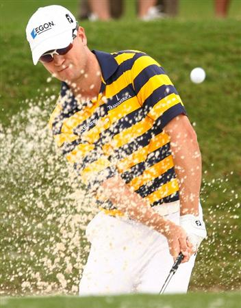 ATLANTA - SEPTEMBER 23:  Zach Johnson hits a bunker shot on the range during a practice round prior to the start of THE TOUR Championship at East Lake Golf Club on September 23, 2009 in Atlanta, Georgia.  (Photo by Scott Halleran/Getty Images)