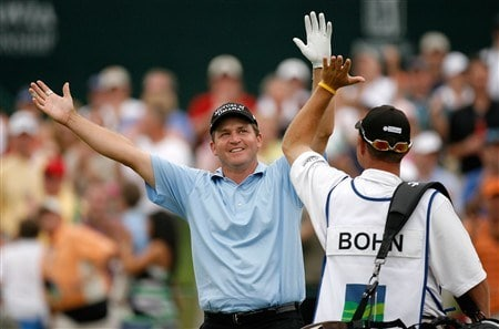 CHARLOTTE, NC - MAY 03:  Jason Bohn celebrates with his caddie after chipping in for par on the 18th hole during the third round of the Wachovia Championship at Quail Hollow Country Club on May 3, 2008 in Charlotte, North Carolina.  (Photo by Streeter Lecka/Getty Images)