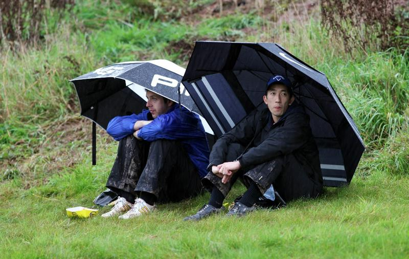 NEWPORT, WALES - OCTOBER 03:  Golf fans watch the action under umbrellas during the  Fourball & Foursome Matches during the 2010 Ryder Cup at the Celtic Manor Resort on October 3, 2010 in Newport, Wales. (Photo by Jamie Squire/Getty Images)