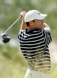 John Huston hits his tee shot at the tenth hole during the fourth round of the Frys.com Open benefiting Shriners Hospitals for Children at TPC Summerlin October 14, 2007 in Las Vegas, Nevada. PGA TOUR - 2007 Frys.com Open - Final RoundPhoto by Stan Badz/PGA TOUR/WireImage.com