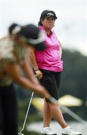 PRATTVILLE, AL - OCTOBER 2:  Pat Hurst, rear, watches as Se Ri Pak of South Korea putts on the ninth green during second round play in the Navistar LPGA Classic at the Robert Trent Jones Golf Trail at Capitol Hill on October 2, 2009 in  Prattville, Alabama.  (Photo by Dave Martin/Getty Images)