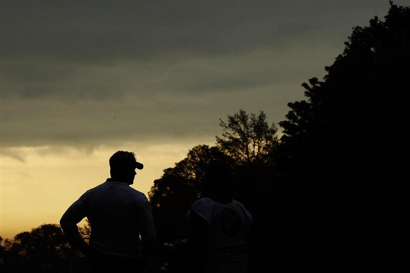 VIRGINIA WATER, ENGLAND - MAY 20:  Peter Hedblom of Sweden prepares to play his tee shot at the 1st hole during the first round of the BMW PGA Championship on the West Course at Wentworth on May 20, 2010 in Virginia Water, England.  (Photo by Warren Little/Getty Images)