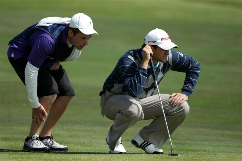 PEBBLE BEACH, CA - JUNE 17:  Matthew Richardson of England lines up a putt with his caddie Joseph Shuchat on the 15th green during the first round of the 110th U.S. Open at Pebble Beach Golf Links on June 17, 2010 in Pebble Beach, California.  (Photo by Andrew Redington/Getty Images)
