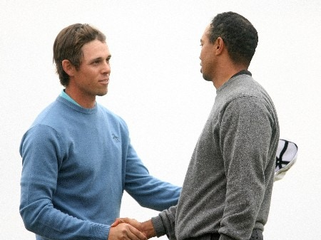 MARANA, AZ - FEBRUARY 22:  Tiger Woods (R) shakes hands with Aaron Baddeley of Australia after Woods won on the 20th hole during the third round matches of the WGC-Accenture Match Play Championship at The Gallery at Dove Mountain February 22, 2008 in Marana, Arizona.  (Photo by Scott Halleran/Getty Images)