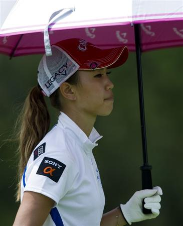 CHON BURI, THAILAND - FEBRUARY 19:  Momoko Ueda of Japan shelters from the sun under her umbrella on the 9th hole during round two of the Honda LPGA Thailand at the Siam Country Club on February 19, 2010 in Chon Buri, Thailand.  (Photo by Victor Fraile/Getty Images)