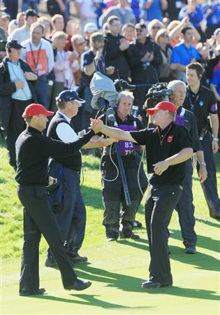 NEWPORT, WALES - OCTOBER 04:  Steve Stricker of the USA is congratulated on winning his match by Vice Captain Davis Love III (L) in the singles matches during the 2010 Ryder Cup at the Celtic Manor Resort on October 4, 2010 in Newport, Wales.  (Photo by David Cannon/Getty Images)