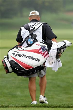LEMONT, IL - SEPTEMBER 11:  Caddie James Edmondson for golfer Ryan Palmer walks with Palmer's bag with an American flag on it during the third round of the BMW Championship at Cog Hill Golf & Country Club on September 11, 2010 in Lemont, Illinois.  (Photo by Jamie Squire/Getty Images)