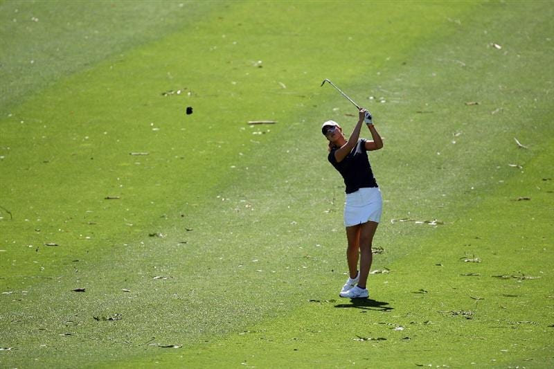 RANCHO MIRAGE, CA - APRIL 03:  Michelle Wie of the USA plays her third shot at the 9th hole amidst all the debris from the trees in the high winds during the second round of the 2009 Kraft Nabisco Championship, at the Mission Hills Country Club on April 3, 2009 in Rancho Mirage, California  (Photo by David Cannon/Getty Images)