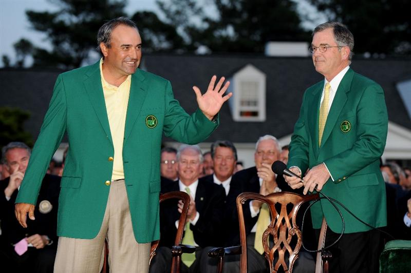 AUGUSTA, GA - APRIL 12:  Angel Cabrera of Argentina waves as he is introduced by William Porter Payne, Chairman of the Augusta National Golf Club and the Masters Tournament, during the green jacket presentation after winning the 2009 Masters Tournament at Augusta National Golf Club on April 12, 2009 in Augusta, Georgia.  Cabrera defeated Kenny Perry on the second sudden death playoff hole to win the tournament. (Photo by Harry How/Getty Images)