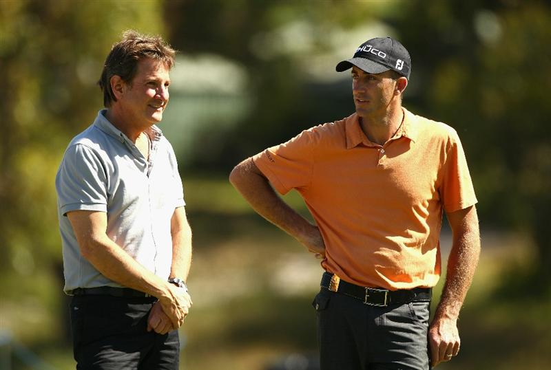 MELBOURNE, AUSTRALIA - NOVEMBER 09:  Geoff Ogilvy (R) of Australia and Commentator Mark Nicholas (L) talk during a practice round during day four of the Australian Masters at The Victoria Golf Club on November 9, 2010 in Melbourne, Australia.  (Photo by Ryan Pierse/Getty Images)