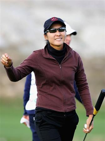 INCHEON, SOUTH KOREA - NOVEMBER 02:  Candie Kung of Chinese Taipei reacts after her putt on the 18th hole during round three of the Hana Bank KOLON Championship at Sky72 Golf Club on November 2, 2008 in Incheon, South Korea.  (Photo by Chung Sung-Jun/Getty Images)