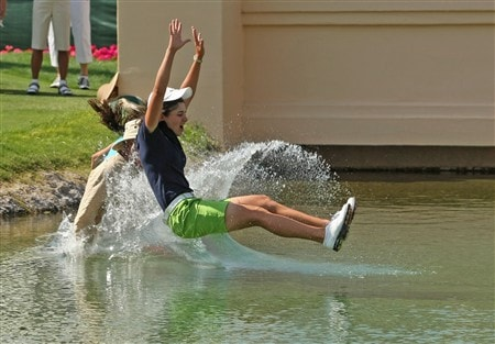 RANCHO MIRAGE, CA - APRIL 6:  Lorena Ochoa of Mexico jumps into the water to celebrate her victory after the final round of the Kraft Nabisco Championship at Mission Hills Country Club on April 6, 2008 in Rancho Mirage, California.  (Photo by Stephen Dunn/Getty Images)